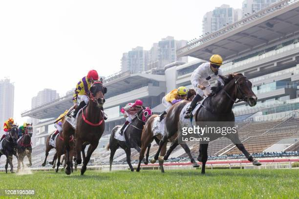 February 23 : Jockey Vincent Ho Chak-yiu riding Golden Sixty wins the Race 7 Hong Kong Classic Cup in front of the empty stands at Sha Tin Racecourse...