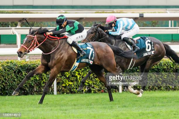 Jockey Vincent Ho Chak-yiu riding Loves Only You wins the FWD QEII Cup race during the FWD Champions Day at Sha Tin Racecourse on April 25, 2021 in...