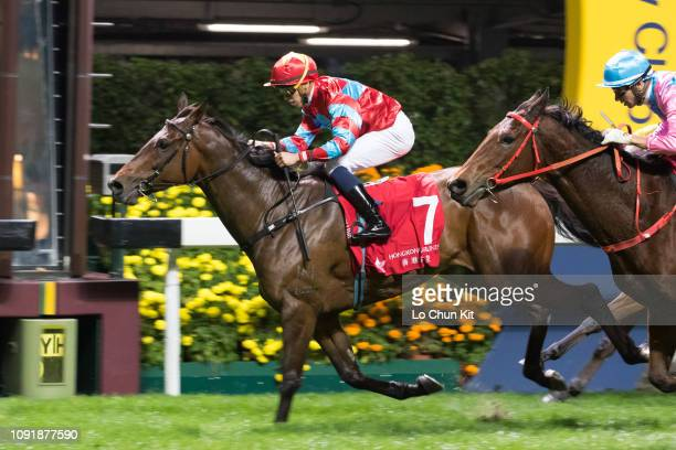 Jockey Vincent Ho Chakyiu riding Racing Luck wins the Race 7 Cleveland Handicap at Happy Valley Racecourse on January 9 2019 in Hong Kong