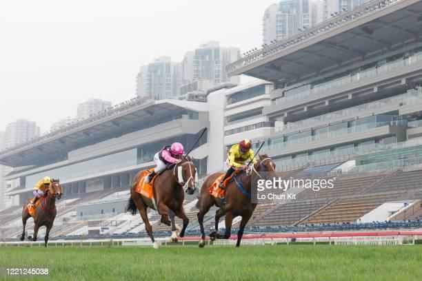 Jockey Vincent Ho Chakyiu riding Southern Legend wins the Race 7 FWD Champions Mile at Sha Tin Racecourse on April 26 2020 in Hong Kong Jockey Zac...