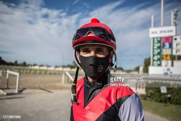 A jockey waits for the race keeping the social distance during competition day as Uruguay slowly returns to normal due to coronavirus outbreak at...