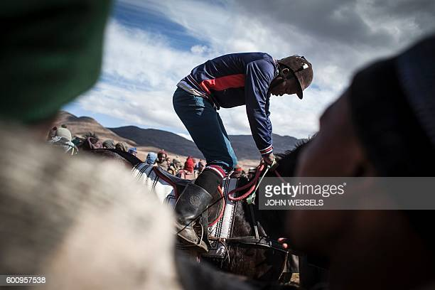 A jockey warms up prior to the race on July 16 2016 in Semonkong Horseracing in the mountain kingdom of Lesotho is not like at Ascot or Longchamp but...