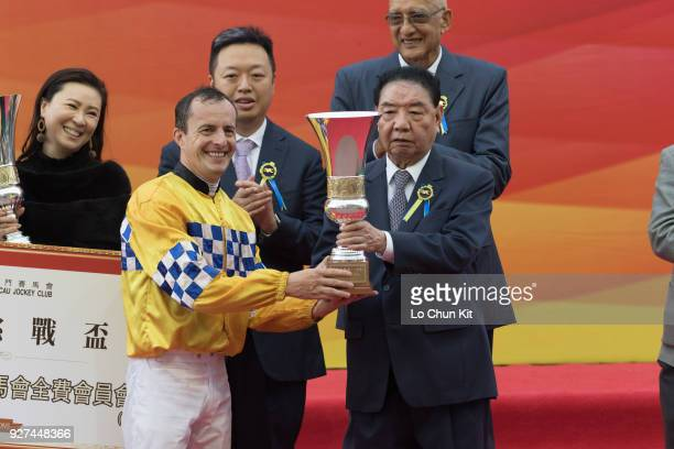 Jockey Wayne Smith receives the trophy after Felizmaster winning Race 6 Chairman's Challenge Cup during Macau Hong Kong Trophy Day at Taipa...