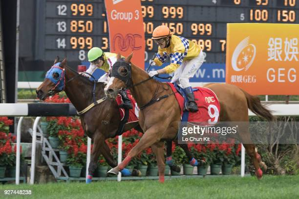 Jockey Wayne Smith riding Felizmaster wins Race 6 Chairman's Challenge Cup during Macau Hong Kong Trophy Day at Taipa Racecourse on March 4 2018 in...