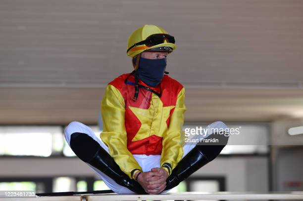 Jockey wearing facial protection si seen on May 07, 2020 in Hanover, Germany. The performance test is the first horse race since the Coronavirus...