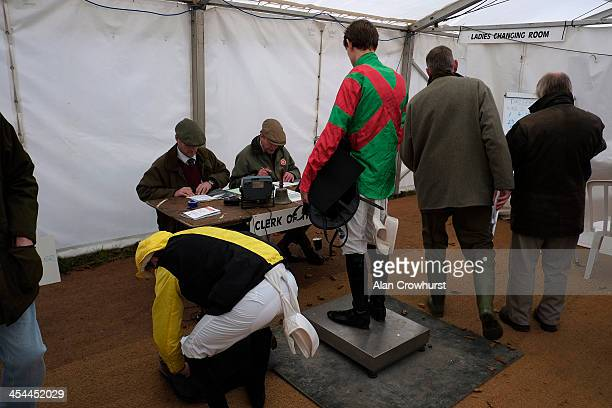 A jockey weighs out during the point to point meeting at Barbury Castle racecourse on December 08 2013 in Swindon England