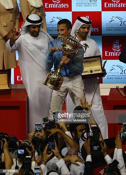 Jockey William Buick and Sheikh Hamdan Bin Mohamed Bin Rashid alMaktoum Crown Prince of Dubai celebrate on the podium after Sheikh's Hamadan horse...