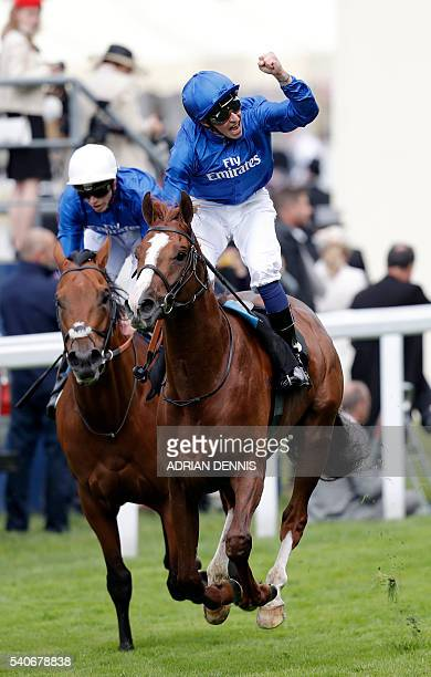Jockey William Buick celebrates as he rides Hawkbill across the finish line to win The Tercentenary Stakes during Ladies' day at Royal Ascot horse...