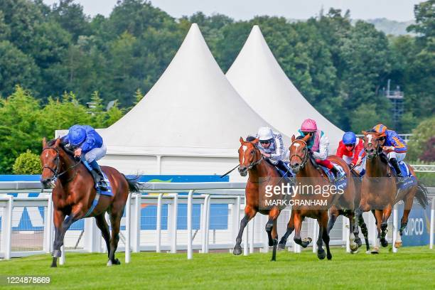 Jockey William Buick rides Ghaiyyath to victory over Enable ridden by jockey Frankie Dettori and Japan ridden by jockey Ryan Moore in The Eclipse...