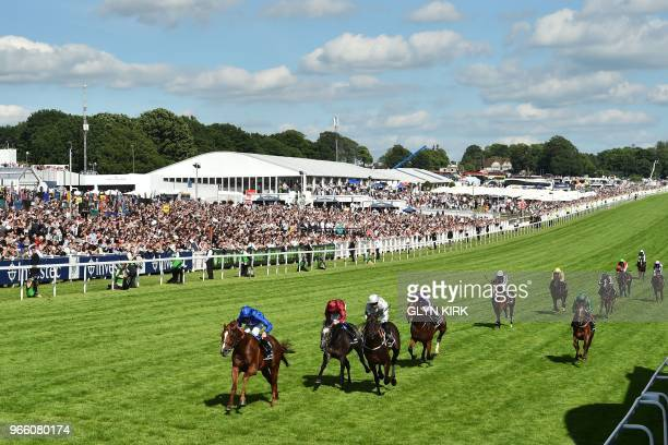 Jockey William Buick rides Masar to victory for breeder Godolphin in the Derby on the second day of the Epsom Derby Festival in Surrey, southern...