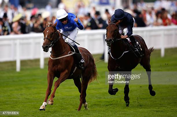 Jockey William Buick riding Buratino celebrates after victory in the Coventry Stakes followed by jockey Ryan Moore in second with Air Force Blue...