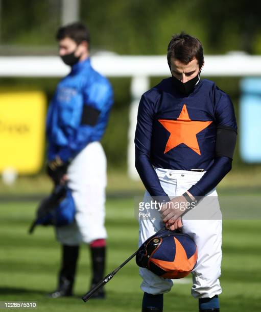 Jockey William Buick stands for a minutes silence in memory of Pat Smullen at Newbury Racecourse on September 18 2020 in Newbury England