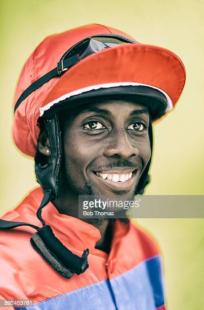 jockey with helmet and goggles - jockey silks stock pictures, royalty-free photos & images