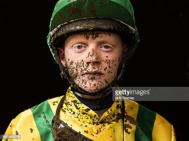 jockey with mud splattered face - horse racing stock pictures, royalty-free photos & images