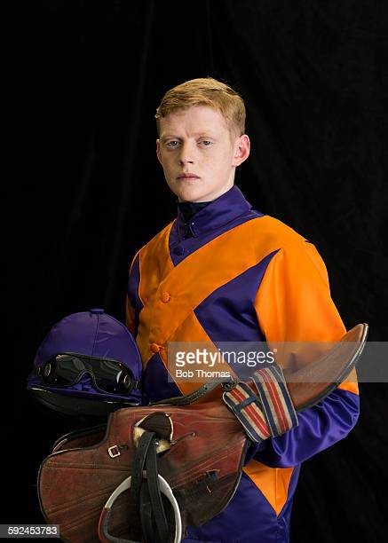 jockey with saddle and helmet - racing silks stock pictures, royalty-free photos & images