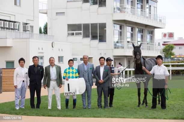 Jockey Yasunari Iwata and owners celebrate after Alma Anon winning the Race 2 at Sapporo Racecourse on August 26 2018 in Sapporo Hokkaido Japan