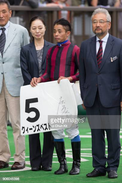Jockey Yasunari Iwata owner Masamichi Hayashi celebrate after Queen's Best winning the Race 5 at Tokyo Racecourse on October 11 2015 in Tokyo Japan