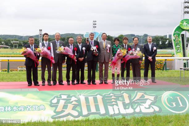 Jockey Yoshitomi Shibata trainer Naosuke Sugai and owner Akatsuki Yamatoya at the trophy presentation ceremony after Just A Way winning the Yasuda...