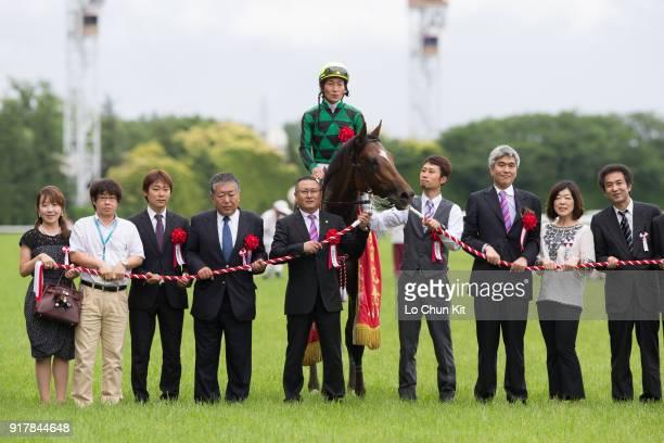 Jockey Yoshitomi Shibata trainer Naosuke Sugai and owner Akatsuki Yamatoya celebrate after Just A Way winning the Yasuda Kinen at Tokyo Racecourse on...