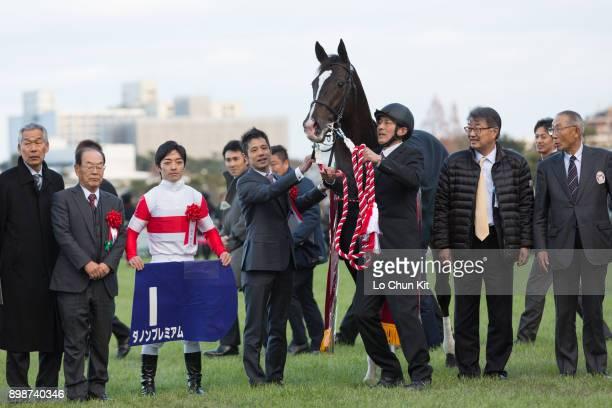 Jockey Yuga Kawada trainer Mitsumasa Nakauchida and owners celebrate after Danon Premium winning the Asahi Hai Futurity Stakes at Hanshin Racecourse...