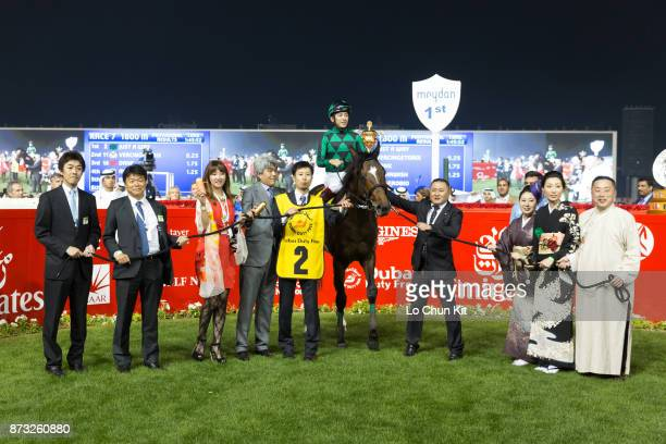 Jockey Yuichi Fukunaga owner Akatsuki Yamatoya trainer Naosuke Sugai celebrate after Just A Way winning the Dubai Duty Free during the Dubai World...