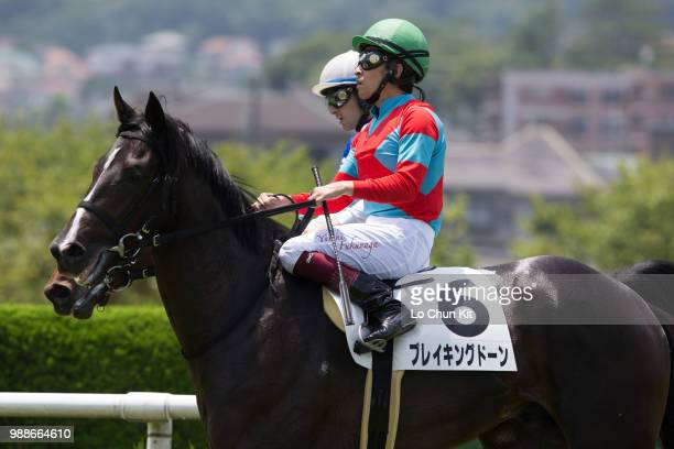 Jockey Yuichi Fukunaga riding Breaking Dawn wins the Race 5 at Hanshin Racecourse on June 24 2018 in Takarazuka Japan