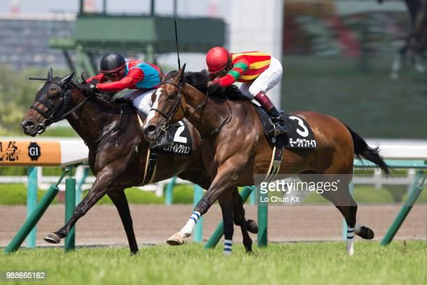 Jockey Yuichi Fukunaga riding Mauve Sapphire wins the Race 8 Izushi Tokubetsu at Hanshin Racecourse on June 24 2018 in Takarazuka Japan