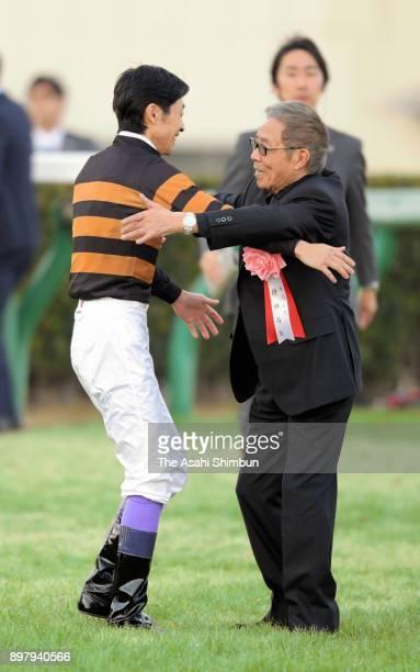 Jockey Yutaka Take and owner and singer Saburo Kitajima after Kitasan Black winning the 62nd Arima Kinen at Nakayama Racecourse on December 24 2017...