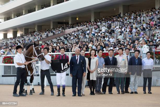 Jockey Yutaka Take and owner Masamichi Hayashi celebrate after Queen's Best winning the Race 9 Chitose Tokubetsu at Sapporo Racecourse on August 27...