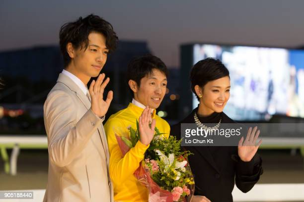 Jockey Yutaka Take Ayame Goriki and Takumi Saito at the presentation ceremony after Copano Rickey winning the JBC Classic at Ohi Racecourse in Tokyo...