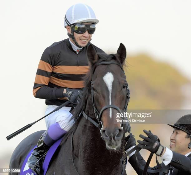 Jockey Yutaka Take riding Kitasan Black celebrates winning the 62nd Arima Kinen at Nakayama Racecourse on December 24 2017 in Funabashi Chiba Japan