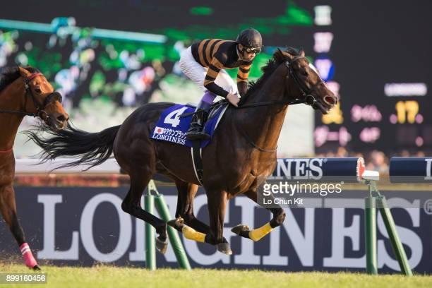 Jockey Yutaka Take riding Kitasan Black during the Japan Cup in association with Longines at Tokyo Racecourse on November 26, 2017 in Tokyo, Japan.