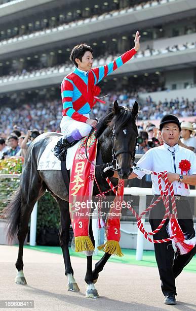 Jockey Yutaka Take riding Kizuna celebrates winning the 80th Japanese Derby at Tokyo Race Course on May 26 2013 in Fuchu Tokyo Japan