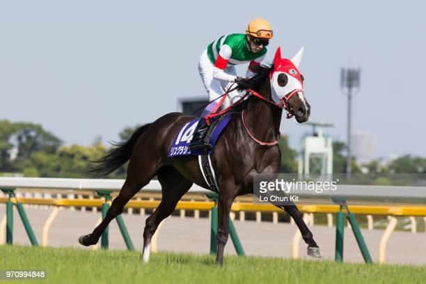 Jockey Yutaka Take riding Lys Gracieux during the Race 11 Yasuda Kinen at Tokyo Racecourse on June 3, 2018 in Tokyo, Japan.