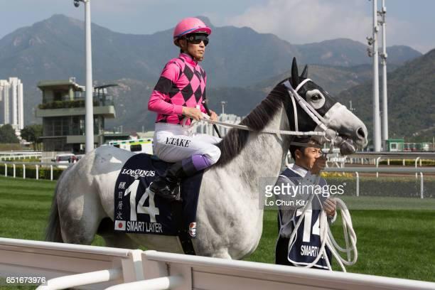 Jockey Yutaka Take riding Smart Layer participate in the Race 4 LONGINES Hong Kong Vase at Sha Tin Racecourse during the Hong Kong International...