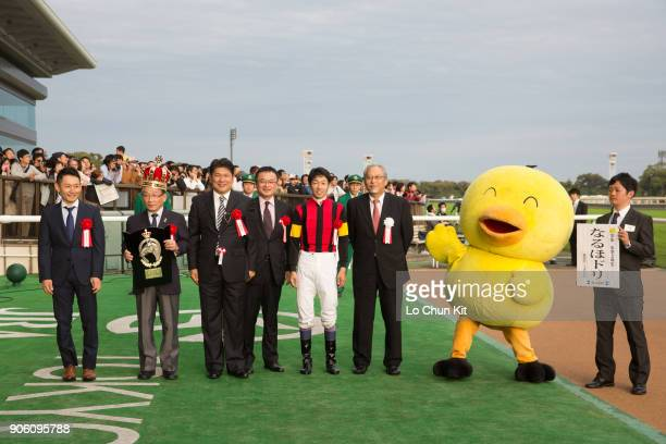 Jockey Yutaka Take trainer Masanori Sakaguchi and owner celebrate after A Shin Hikari winning the Mainichi Okan at Tokyo Racecourse on October 11...