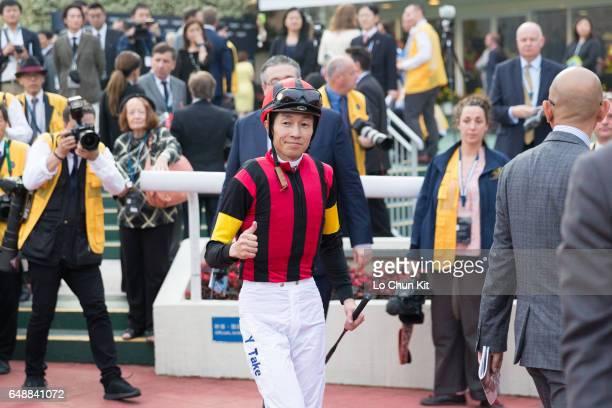 Jockey Yutaka Take wins the Longines Hong Kong Cup during the Hong Kong International Races Day at Sha Tin racecourse on December 13 2015 in Hong...