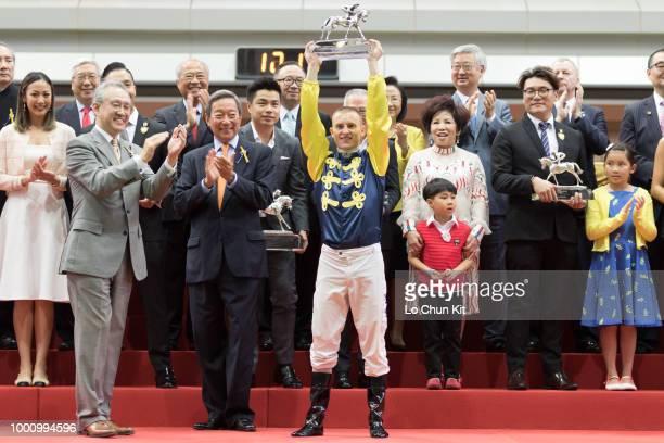 Jockey Zac Purton celebrates his second Champion Jockey title at Sha Tin racecourse during the Season Finale race day on July 15 2018 in Hong Kong...