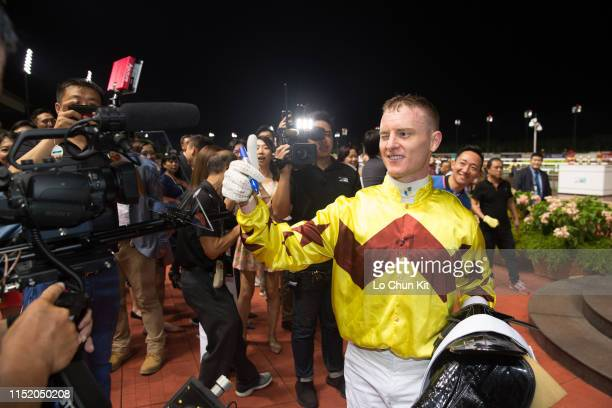 Jockey Zac Purton gives his autograph on video camera after Hong Kong runner Southern Legend winning Race 9 Kranji Mile at Kranji Racecourse on May...