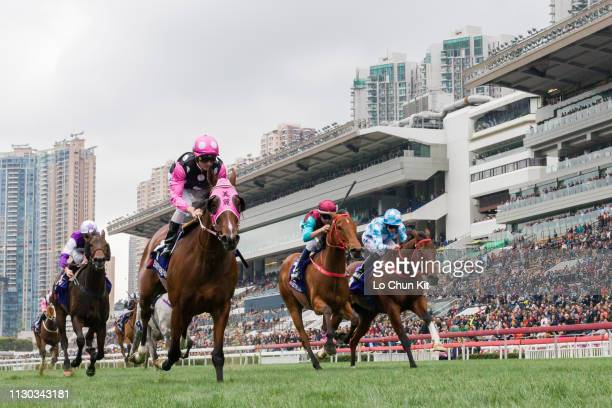 Jockey Zac Purton riding Beauty Generation wins Race 6 The Queen's Silver Jubilee Cup at Sha Tin racecourse on February 17, 2019 in Hong Kong. Beat...