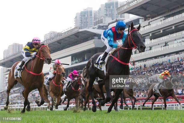 Jockey Zac Purton riding Dark Dream wins the Race 9 Harlech Handicap at Sha Tin Racecourse on April 7, 2019 in Hong Kong.