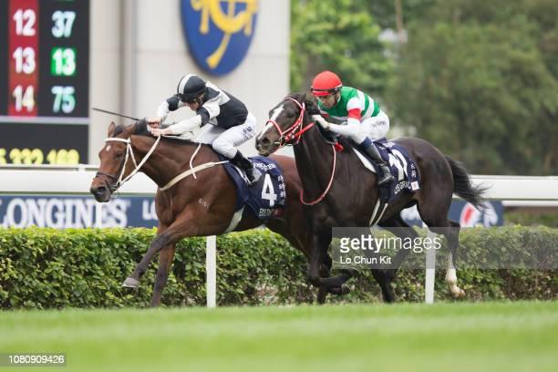 Jockey Zac Purton riding Exultant wins Race 4 Longines Hong Kong Vase at Sha Tin racecourse during the LONGINES Hong Kong International Races Day at...