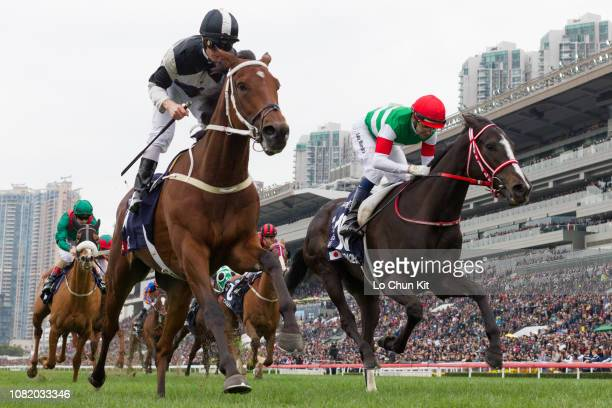 Jockey Zac Purton riding Exultant wins Race 4 Longines Hong Kong Vase during the LONGINES Hong Kong International Races Day at Sha Tin Racecourse on...