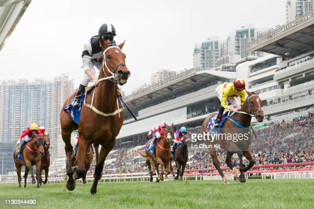 Jockey Zac Purton riding Exultant wins Race 7 The Citi Hong Kong Gold Cup at Sha Tin racecourse on February 17, 2019 in Hong Kong. Jockey Chad...