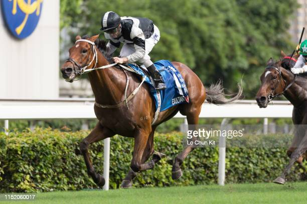 Jockey Zac Purton riding Exultant wins Race 8 Standard Chartered Champions Chater Cup at Sha Tin Racecourse on MAY 26 2019 in Hong Kong