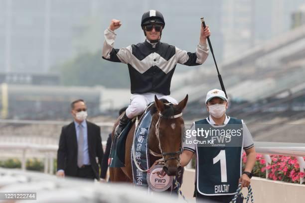 Jockey Zac Purton riding Exultant wins the Race 8 FWD Queen Elizabeth II Cup at Sha Tin Racecourse on April 26 2020 in Hong Kong Jockey Zac Purton...