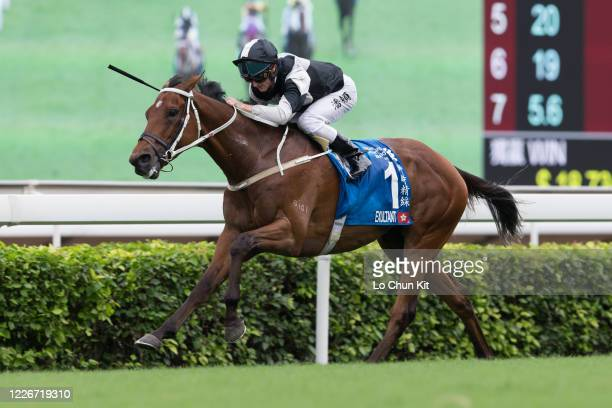 Jockey Zac Purton riding Exultant wins the Race 8 Standard Chartered Champions Chater Cup at Sha Tin Racecourse on May 24 2020 in Hong Kong