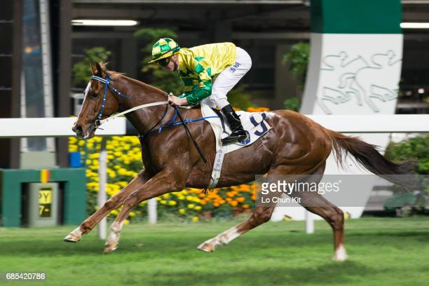 Jockey Zac Purton riding Grace Heart wins the Race 1 Deauville August Yearling Sales Handicap at Happy Valley Racecourse on May 17 2017 in Hong Kong...
