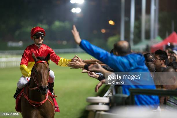 Jockey Zac Purton riding Starlight wins the Race 8 Perfect Gear Handicap at Happy Valley Racecourse on October 25 2017 in Hong Kong Hong Kong