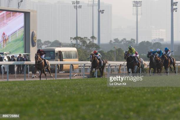 Jockey Zac Purton riding Time Warp wins the LONGINES Hong Kong Cup at the Sha Tin Racecourse during the LONGINES Hong Kong International Races Day on...